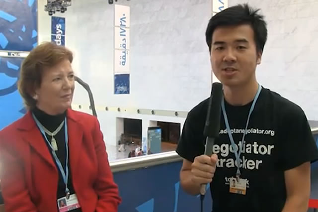 Marvin Nala, China Tracker talking with Mary Robinson at COP18 in Doha
