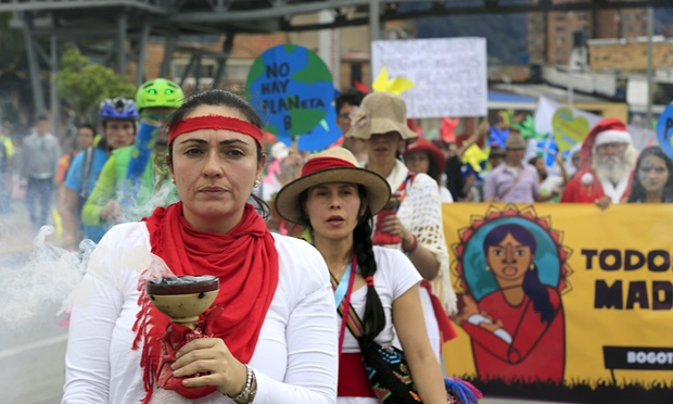 Women activists march ahead of the 2015 Paris Climate Change Conference in Bogota, Colombia. Photograph: Jose Miguel Gomez/Reuters - The Guardian
